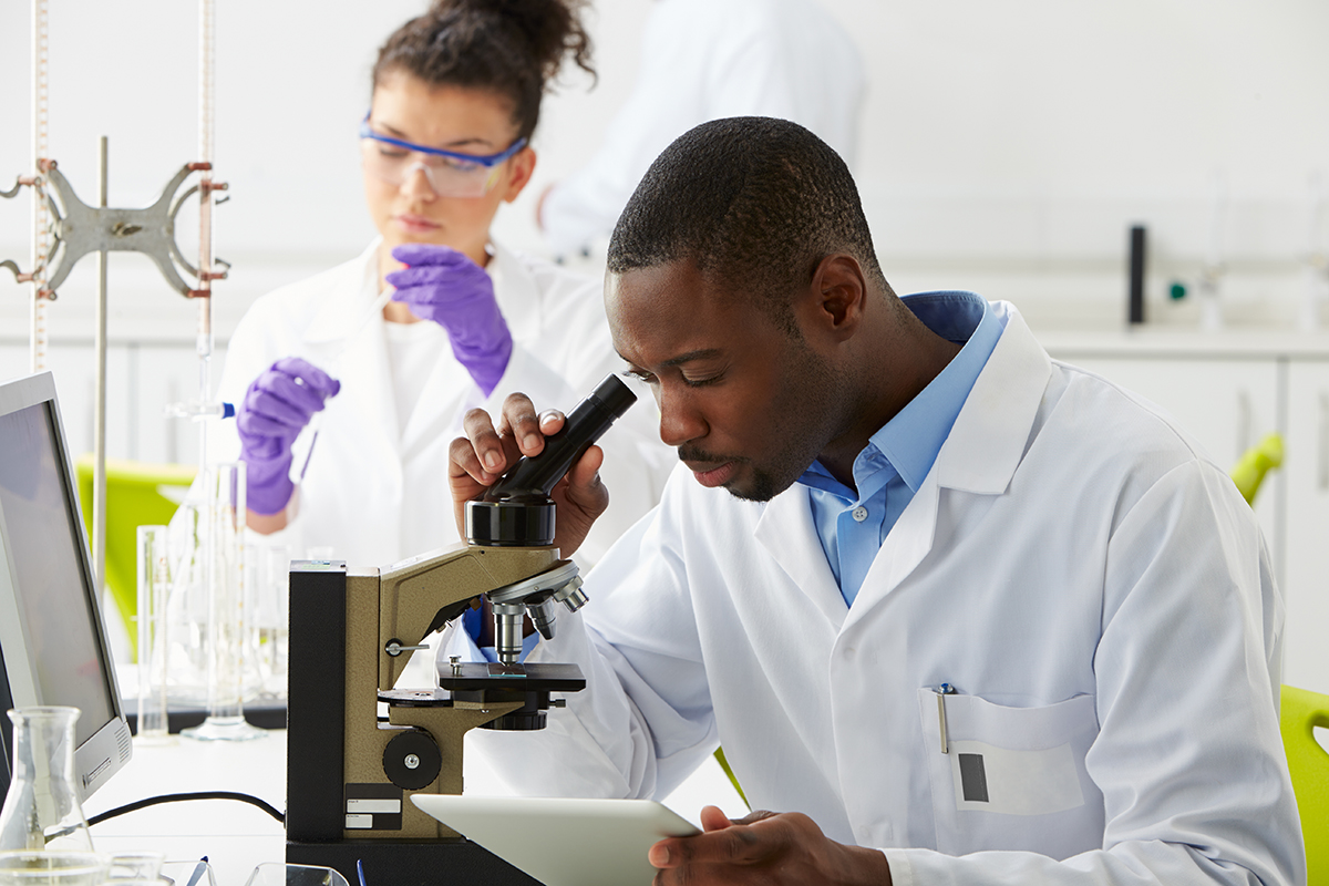 Man-at-Microscope